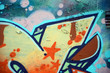 Street art. Abstract background image of a fragment of a colored graffiti painting in beige and orange tones