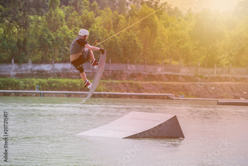 Fotografie, Obraz  wakeboarding at the wake park. Outdoor and extreme sport.