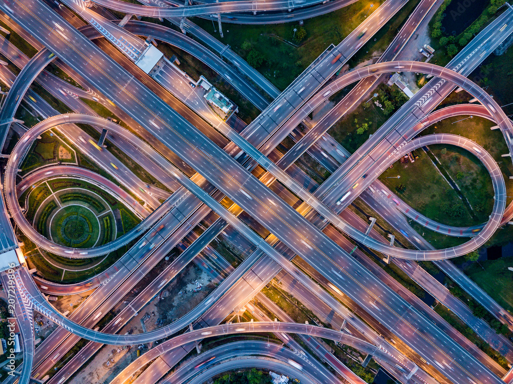 Fototapety, obrazy: Top view of Highway road junctions at night. The Intersecting freeway road overpass the eastern outer ring road of Bangkok, Thailand.
