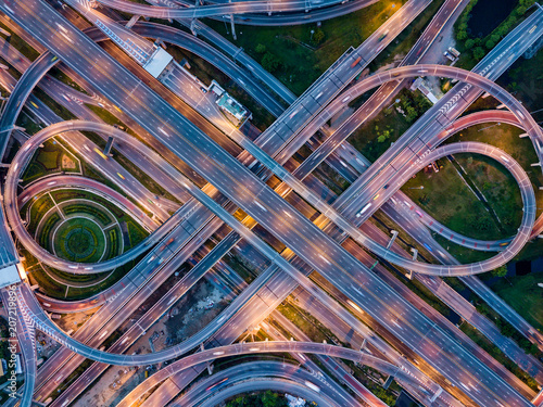 Fotobehang Nacht snelweg Top view of Highway road junctions at night. The Intersecting freeway road overpass the eastern outer ring road of Bangkok, Thailand.