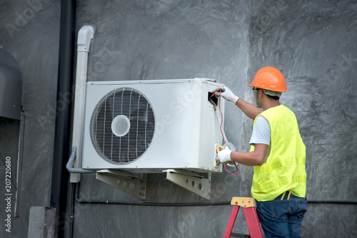 Technician is checking outdoor air conditioner unit Canvas Print