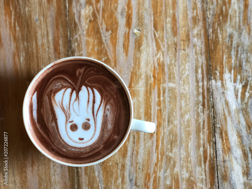 "cute Latte art coffee on the wooden table, latte art coffee shape look like ""Groot"" , One of the actors in the Avengers: Infinity War Poster"