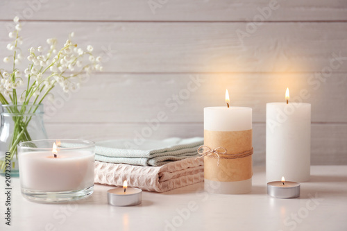 Fototapety, obrazy: Beautiful composition with burning wax candles on table