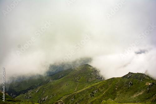 Fotobehang Wit Beautiful cloudy mountain landscapes