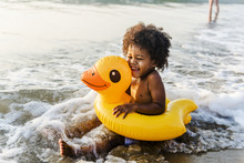 Cute Toddler With Duck Tube On...
