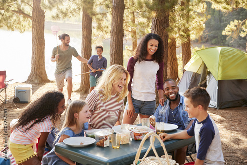 Ingelijste posters Kamperen Family With Friends Camp By Lake On Hiking Adventure In Forest