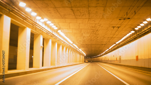 In de dag Tunnel Road bridge subway underground tunnel illuminated at night city lights