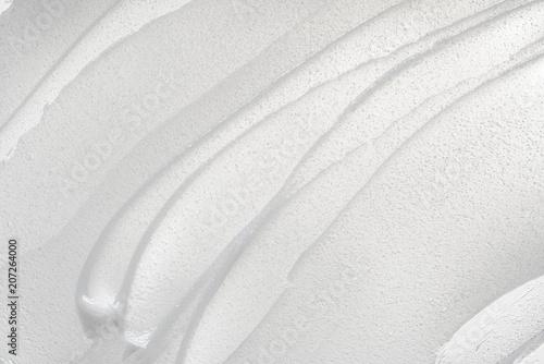 Fotografia Texture of cream on white background