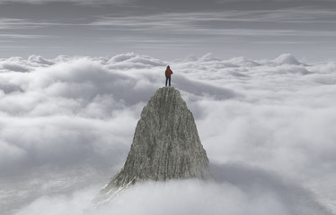 FototapetaA man standing on a stone cliff over the clouds
