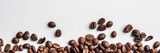 Panorama with coffee scattered on a white background