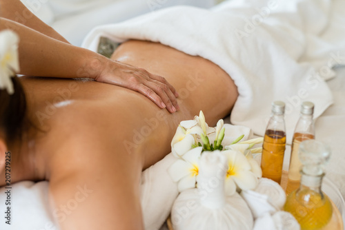 Fotografie, Obraz  Young beautiful Asian woman sleep relaxing in the Oil spa massage in salon