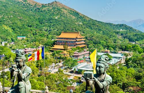 Tuinposter Aziatische Plekken Buddhist statues at Ngong Ping, on the way to Tian Tan Buddha. Hong Kong