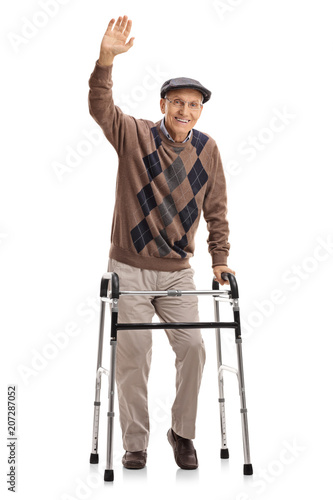 Senior with a walker waving at the camera Fototapet