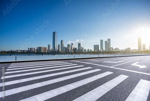 city skyline with empty asphalt road in urban Poster
