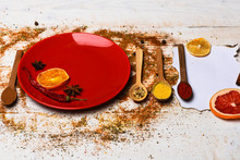 Spices Scattered All Over Wood...