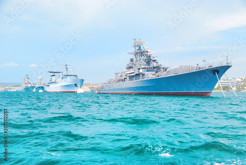 Fototapeta Military navy ship in blue sea with sky and clouds