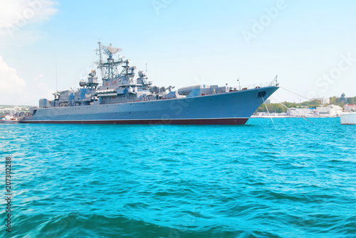 Obraz na plátně Military navy ship in blue sea with sky and clouds