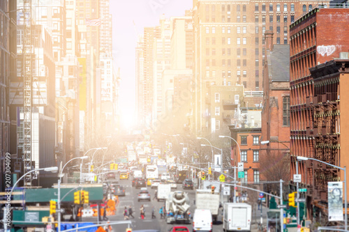 Fototapeten New York Sunlight shines down the busy streets of Chelsea in Manhattan, New York City NYC