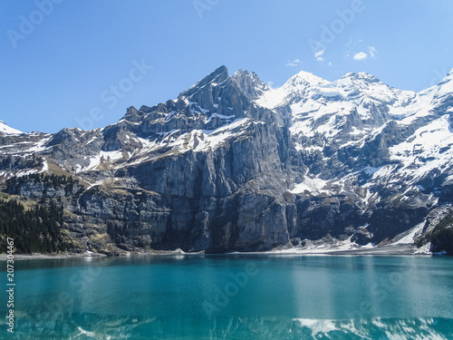 Photo Stands Night blue Amazing tourquise Oeschinnensee with Swiss Alps Kandersteg