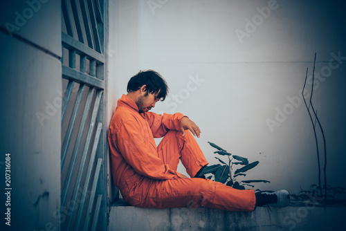 Valokuva  Portrait of asian handsome man in Prison uniforms,He has a lot Mustache and mess