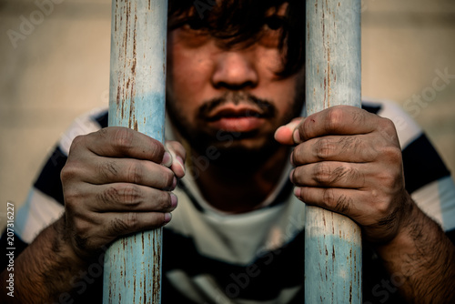 Fotografie, Tablou  Hands of men desperate to catch the iron prison,prisoner concept,thailand people,Hope to be free,crime should be punished more severely,A person guilty are punished