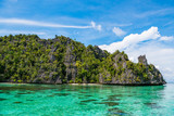 East Misool, group of small island in shallow blue lagoon water, Raja Ampat, West Papua, Indonesia