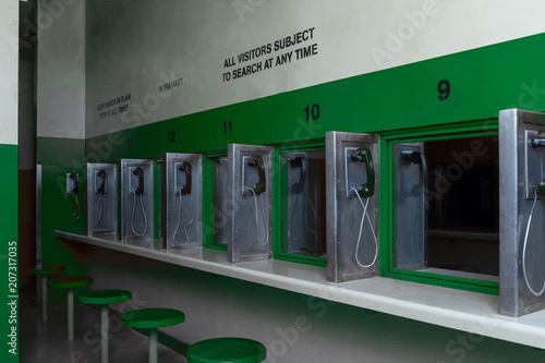 Fotografia, Obraz  jail prison visiting area with glass partitions separation