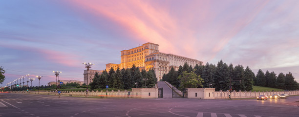 Panorama of the Palace of the Parliament, Bucharest, Romania. Colorful Sunset