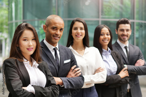 Fototapety, obrazy: Portrait of business people of different ethnic backgrounds dressed in suits, they smile and cross their arms. Concept of: internationality and career, cooperation and team.