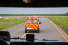 Follow Me Car At The Airport Accompanies The Passenger Shuttle To The Plane