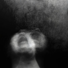 Scream Of Horror. Screaming Woman Face. Shot With Long Exposure.