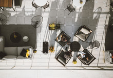 Overhead View Of Business People Talking On Office Rooftop