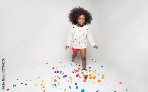 Portrait of smiling girl posing against white background