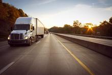 White 18 Wheeler Truck On Highway At Sunrise