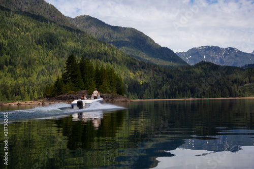Fotobehang Meer / Vijver Motor Boat passing in the water surrounded by beautiful Canadian Mountain Landscape. Taken in Stave Lake, East of Vancouver, British Columbia, Canada.