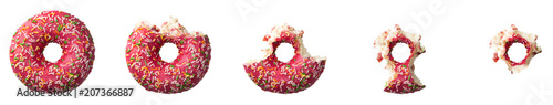 фотография The process of eating a donut with colorful sprinkles isolated on white background