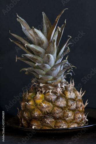 Fototapety, obrazy: Closeup of pineapple on black background.