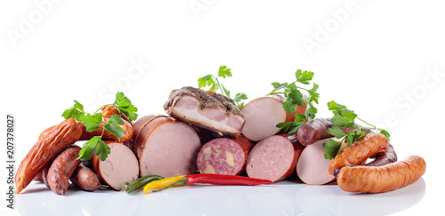 Staande foto Vlees Different sausages and smoked meats isolated on white .