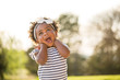 canvas print picture - Happy little girl laughing and smiling outside.
