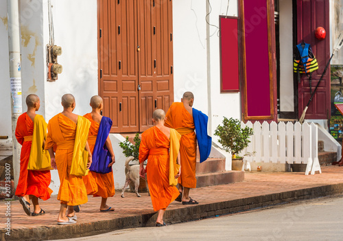 LUANG PRABANG, LAOS - JANUARY 11, 2017: Monks on a city street. Copy space for text.