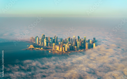 Fototapeta  Aerial view of Doha through the morning fog - Qatar, the Persian Gulf