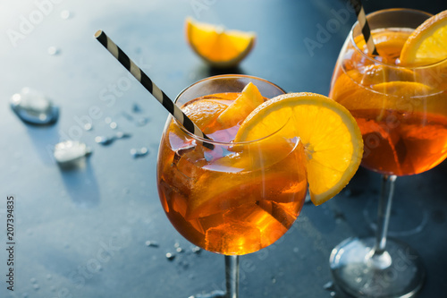 Classic italian aperol spritz cocktail on dark.