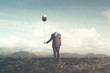 canvas print picture - man without head holds black balloon with hat surreal concept