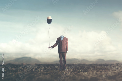 man without head holds black balloon with hat surreal concept Canvas Print