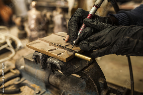 Employee working on details on metal piece