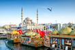 Leinwandbild Motiv ISTANBUL, TURKEY - October 6, 2015: View of the Suleymaniye Mosque and fishing boats in Eminonu, Istanbul, Turkey