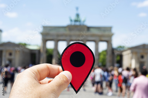Photo  man with a red marker in the Brandenburg Gate