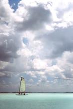 People Sailing Boat On Sea