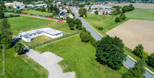 Fotografie, Obraz  Aerial view of the clubhouse of a regional football club on the outskirts of the