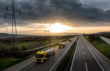 Caravan Or Convoy Of Tank Trucks In Line On A Country Highway